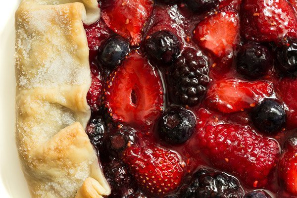 Overhead closeup of a 10 Minute Summer Berry Galette with the crust on the left and berry center on the right.