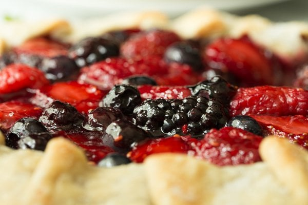 Closeup side photo of a 10 Minute Summer Berry Galette with the crust in the foreground.