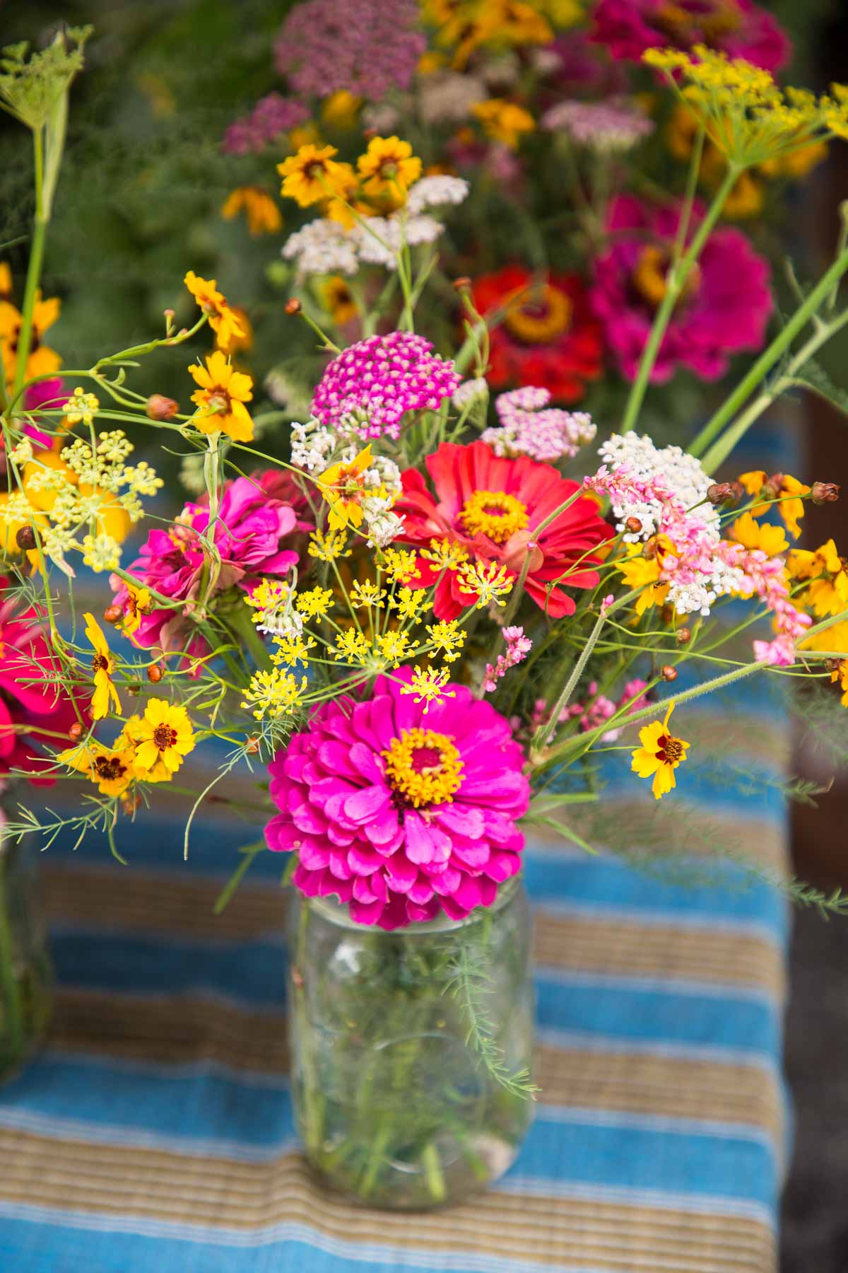 Closeup photo of western North Carolina wild flowers in a vase at a farmer's market.