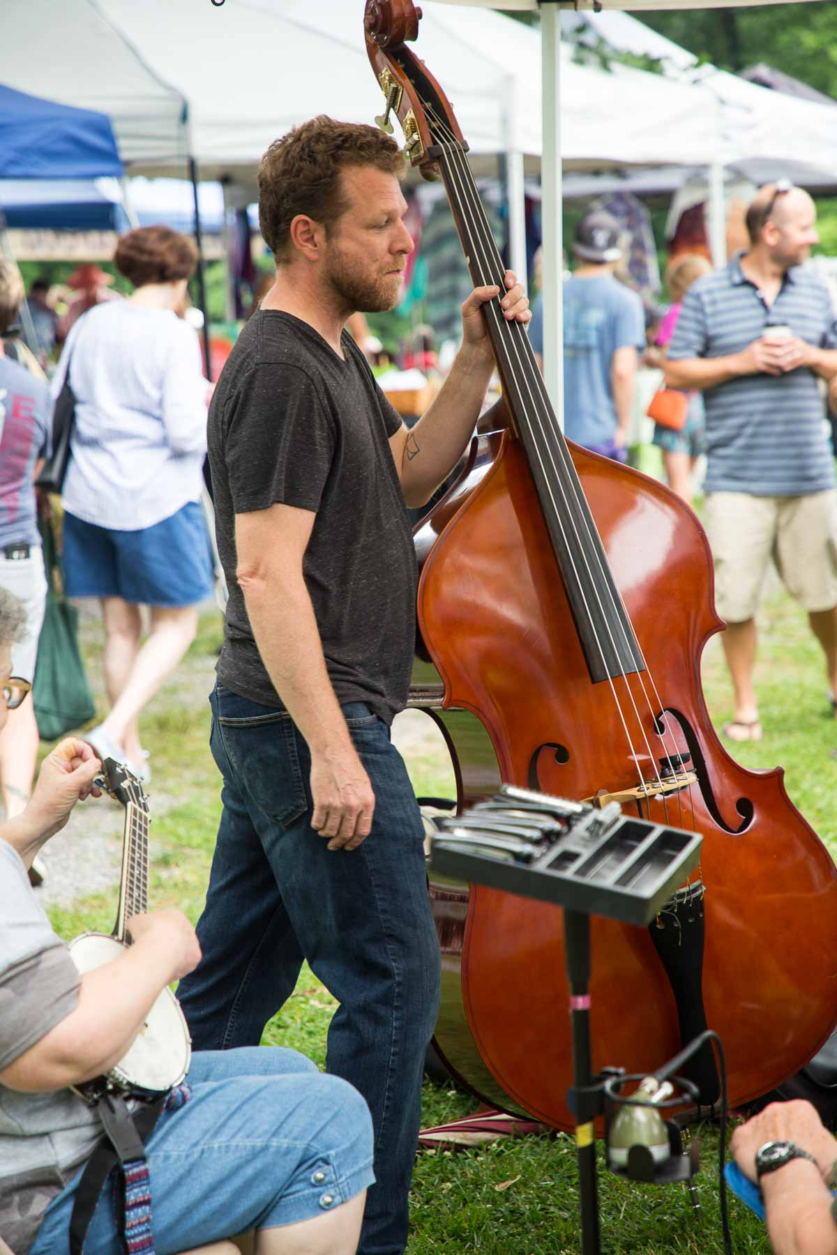 Photo of a local western North Carolina band tuning up for a farmer's market concert.