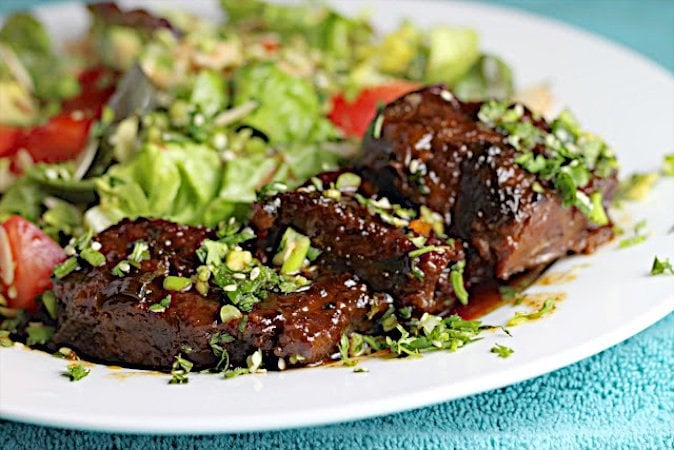 These Korean Beef Short Ribs with Perfect Jasmine Rice are fork-tender Asian short ribs, slow roasted with a sweet, flavorful sauce with hints of ginger, soy, garlic and sesame.