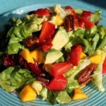 Strawberry Mango Salad with Pomegranate-Lemon Vinaigrette and Honey Toasted Pecans