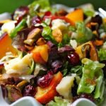 Salad with Fresh Peaches, Drunken Craisins, Gorgonzola, Sweet Roasted Pistachios, with Fig & White Balsamic Vinaigrette