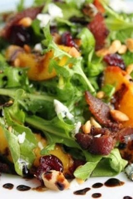 Arugula Salad with Grilled Peaches, Applewood Bacon, Blue Cheese and Toasted Macadamia