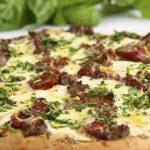 Pesto Pizza w/ Italian Sausage, Slow-Roasted Tomatoes & Spring Herb Gremolata