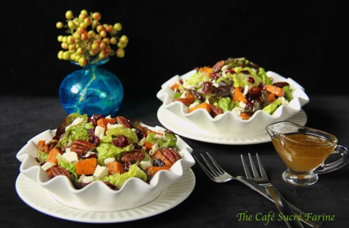 """Roasted Sweet Potato Salad with Honey-Cumin Vinaigrette - This salad screams, """"FALL"""", with roasted sweet potatoes, sea-salted pecans, dried cranberries and Feta cheese. Topped off with a delicious, inspiring honey-cumin vinaigrette, this salad will be at the top of your fall healthy eating list."""