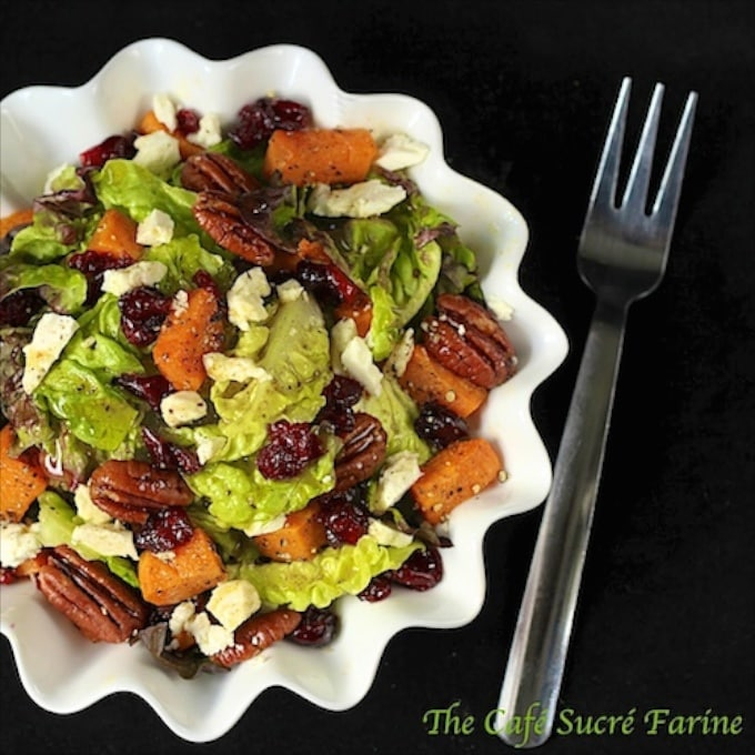 "Roasted Sweet Potato Salad with Honey-Cumin Vinaigrette - This salad screams, ""FALL"", with roasted sweet potatoes, sea-salted pecans, dried cranberries and Feta cheese. Topped off with a delicious, inspiring honey-cumin vinaigrette, this salad will be at the top of your fall healthy eating list."