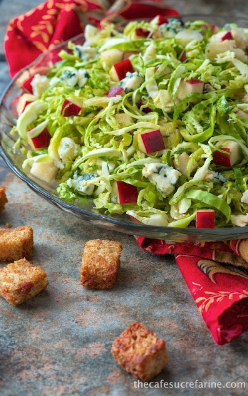Shaved Brussels Sprouts and Apple Salad with Cider Vinaigrette - a delicious, rustic, fall salad with tons of flavor. The cider vinaigrette harkens back to gorgeous apple orchards and trees laden with bright, crisp, sweet apples.