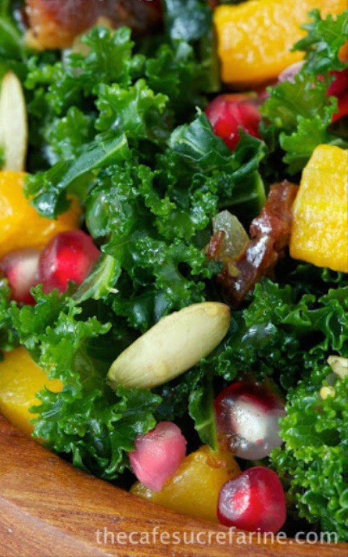 Massaged Kale and Butternut Squash Salad with Warm Apple Cider Dressing - an amazingly healthy, flavorful fall salad with kale, pomegranates, roasted squash and onions, all topped off with a delicious apple cider-bacon dressing. What's not to love?