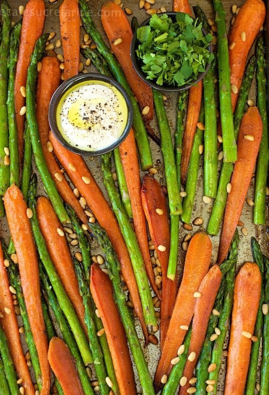 Brown Sugar and Spice Roasted Veggies with Lemon-Garlic Yogurt Sauce - Who says veggies can't rock? These are veggies with a Mediterranean flair!