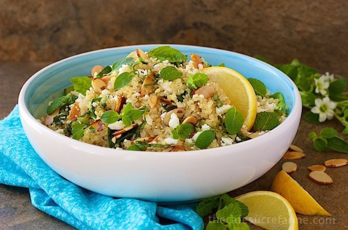 Lemon Quinoa Salad is a fresh, healthy salad with a lemony vinaigrette, baby spinach, fresh herbs, crumbled Feta, and a  shower of toasted butter almonds.