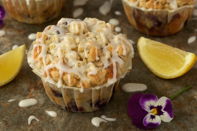 Bakery Style Blueberry Muffins. Tender and moist with a fabulous buttery crumb topping and a lemony drizzle!