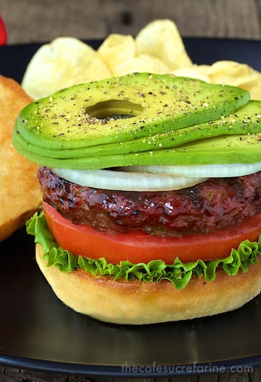 California Avocado Western Burgers- these delicious burgers are some of our favorites, loaded with great southwestern flavor and topped with soft, creamy avocados. There's a fun trick for cutting avocados too! thecafesucrefarine.com
