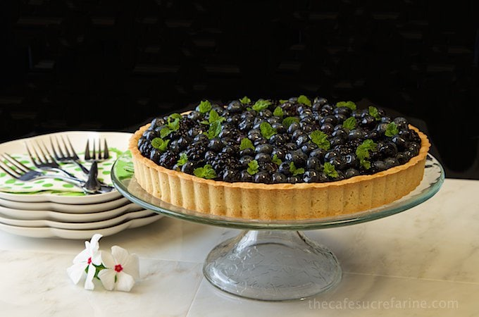 Lemon Cheesecake with Glazed Berries and Shortbread Crust. A delicious fresh berry topped no-bake lemon cheese cake in a crisp, buttery shortbread crust.