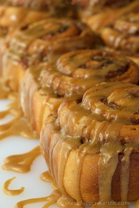 Side photo of a row of Easy Cinnamon Rolls with Caramel Icing.