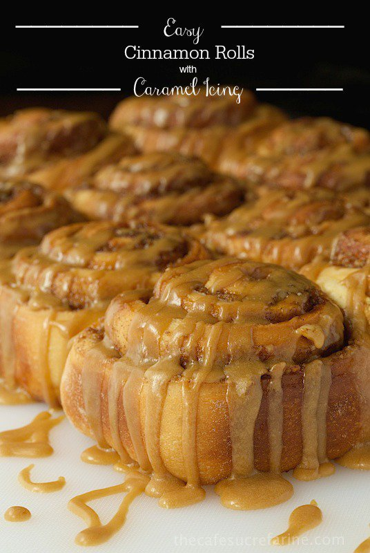 "Side photo of Easy Cinnamon Rolls with Caramel Icing on a white bread board. Graphic title ""Easy Cinnamon Rolls with Caramel Icing"" on top of photo."