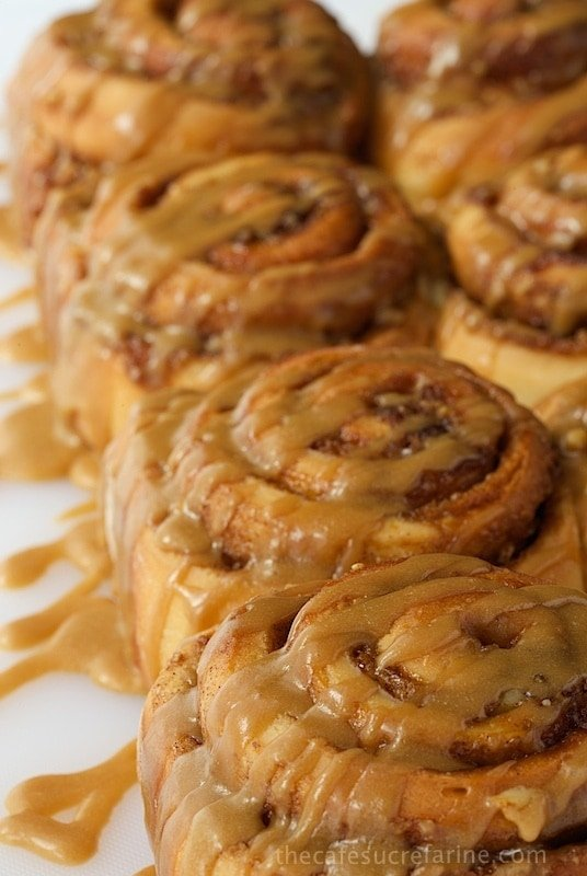 Photo of a row of Easy Cinnamon Rolls with Caramel Icing.