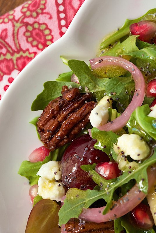 Arugula, Pear and Pom Salad - a fabulous fresh salad with fresh pears, pomegranate arils and juicy red grapes. A poppy seed and apple cider dressing is the perfect pairing!