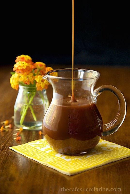 Vertical picture of Buttermilk Maple Toffee Sauce in a glass cruet