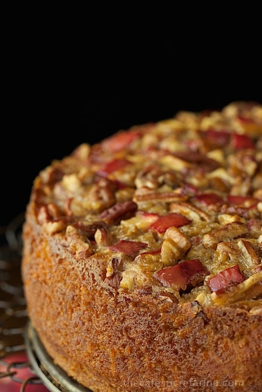 Close up vertical picture of sticky apple pecan cake