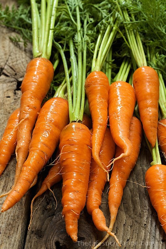 Photo of a bunch of raw carrots for making Honey Maple Roasted Carrots.