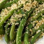 Green Bean casserole, it's a given, right? How about being a bit of a renegade this year? How about ... fresh, tender green beans tossed in a light, lemony butter sauce and topped with crisp, lemon-herb panko crumbs? I know, I know, Green Bean casserole is a family institution and even better more than that, it can be made ahead and just popped in the oven at the towards the end of the holiday meal prep. Guess what? Although these delicious green beans may not be a family institution, they have the potential to become quite revered and even better than that, everything can be done ahead and then warmed a few minutes before serving. The beans are quickly blanched, then drained and plunged into cold, icy water to stop the cooking process. The lemony, buttery panko crumbs also take just a few minutes to prepared and can be stored in a zippered bag or small glass jar till it's time for dinner. All that's needed later is a hot pan to melt the butter and toss the brightly hued beans. Transfer them to a serving platter, scatter with the flavorful crumbs and dazzle your guests. That's it! Start a new tradition. They'll be begging for this one again and again!