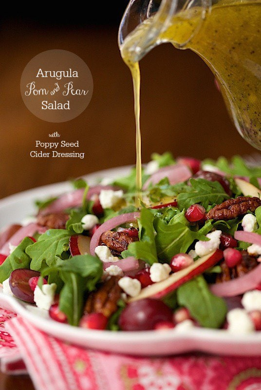 Arugula, Pom and Pear Salad - a beautiful salad that tastes even better than it looks. The Cider Poppy Seed Dressing is amazing!