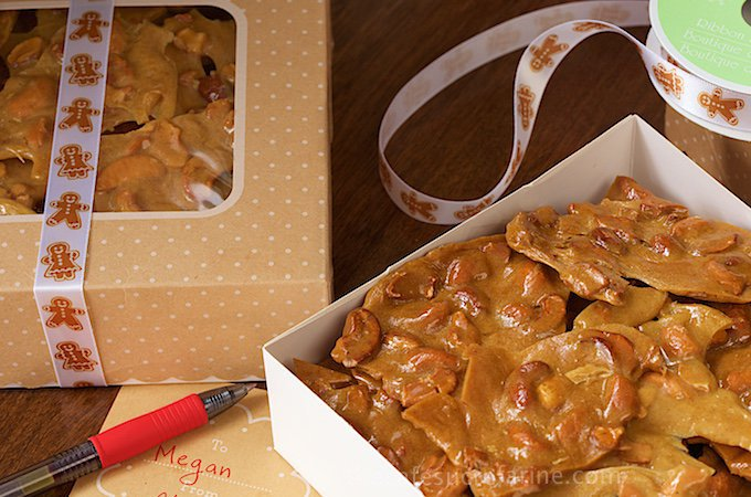 Easy Cashew Curry Brittle - just like peanut brittle but way better! It's a deep golden-hued candy with cashews and a touch of curry which adds a wonderful depth of flavor. Make it in minutes - in the microwave!