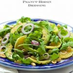 Orange and Avocado Salad - fresh and delicious with sweet oranges, creamy avocado, crunchy peanuts and the most delicious sweet-salty-spicy dressing. You'll want to pour it over everything!