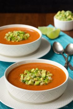 Southwestern Tomato and Roasted Red Pepper Soup - hearty, healthy and super flavorful, this soup is loaded with lots of great veggies and a burst of south-of-the-border flavor. The avocado salsa takes it right over the top!