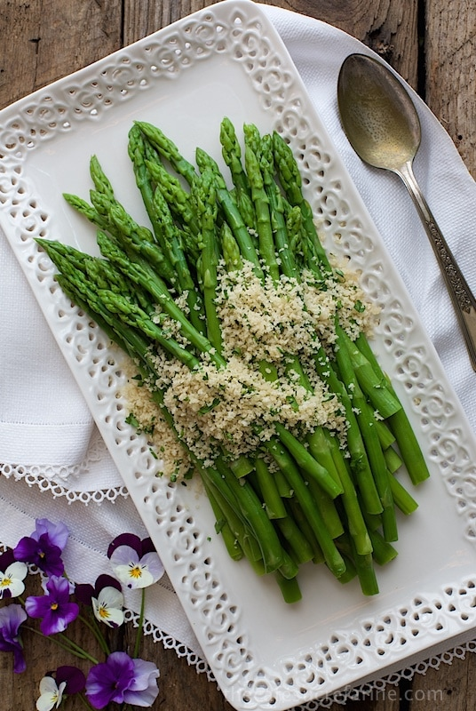 Overhead picture of Asparagus with Lemon Parsley Panko on a white platter