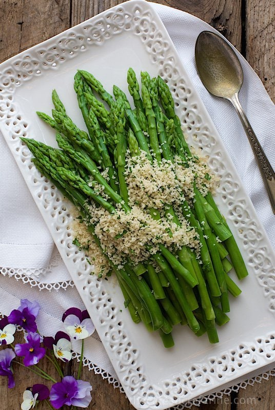 Overhead photo of Asparagus with Lemon Parsley Panko on a white platter.