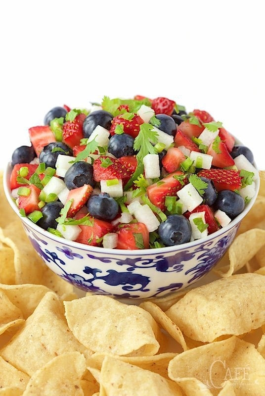 Vertical picture of Red, White and Blue Salsa in a white and blue bowl with chips