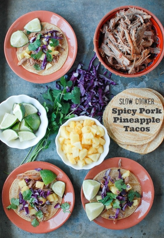 Slow Cooker Spicy Pork Pineapple Tacos - if slow cooked pork is on the menu at a Mexican restaurant, I'm all over it. It's even better to have a stash of your own at home!