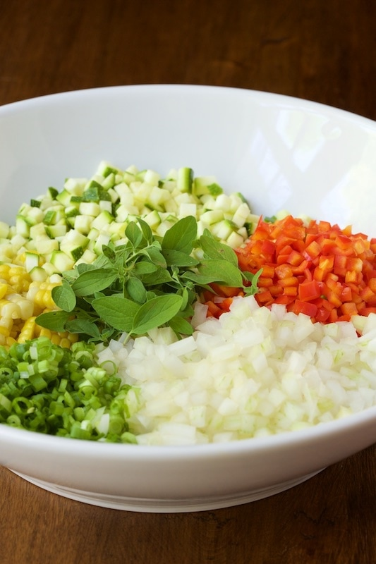 Close up picture of chopped vegetables in a white bowl