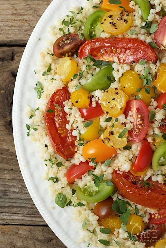 Ottolenghi's Tomato Party Couscous Salad - quintessentially summer, this fun pasta salad is delicious, healthy and make-ahead. It's perfect for pot lucks, parties and picnics. www.thecafesucrefarine.com