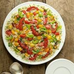 Ottolenghi's Tomato Party Couscous Salad - quintessentially summer, this fun pasta salad is delicious, healthy and make-ahead. It's perfect for pot lucks, parties and picnics.