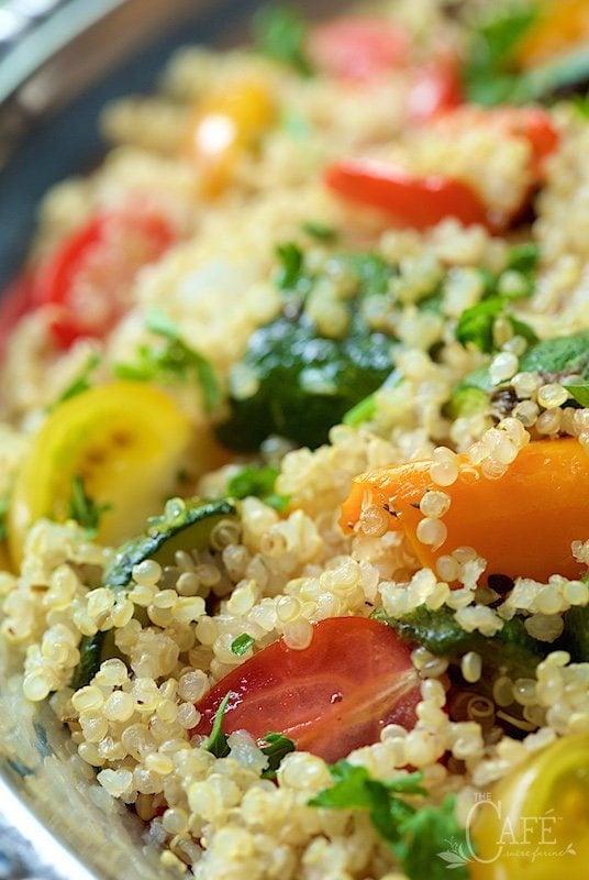 Extreme closeup side photo of Roasted Ratatouille Quinoa Salad on a silver platter.