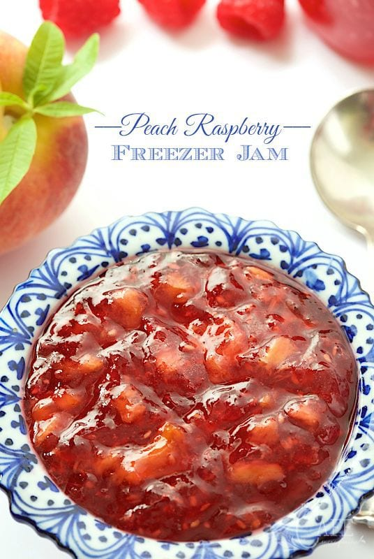 It takes just thirty minutes to throw together a batch of this yummy Peach Raspberry Freezer Jam! It's really easy and you'll be thanking yourself over and over, when the cold winds blow! www.thecafesucrefarine.com
