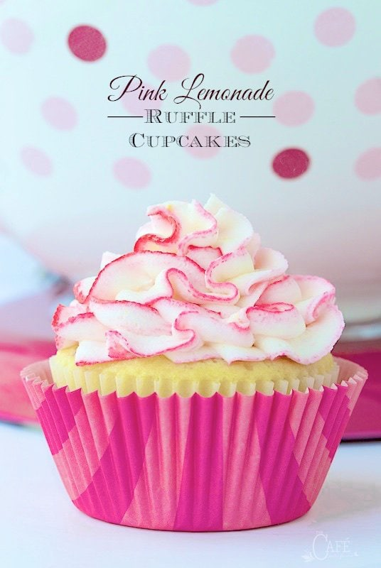 Pink Lemonade Ruffle Cupcakes - Super moist, lemony cupcakes studded with bits of delicious raspberry - a flavor match made in heaven! Oh and the crème de la crème? A super fun, crazy good lemon buttercream ruffles tinged with pink (or any color you choose). thecafesucrefarine.com