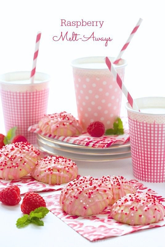 Raspberry Melt Aways - these simple but crazy good butter cookies have a fabulous, fresh raspberry drizzle icing! They're really fun cookies to make with kids as there's just a few ingredients and an easy technique. thecafesucrefarine.com