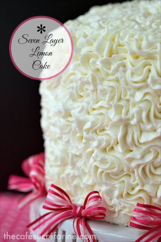 Seven Layer Lemon Cake with Blackberry Buttercream Filling - this stunning layer cake is absolutely a show stopper for your next special occasion. With the blackberry buttercream filling, it tastes even better than it looks! thecafesucrefarine.com