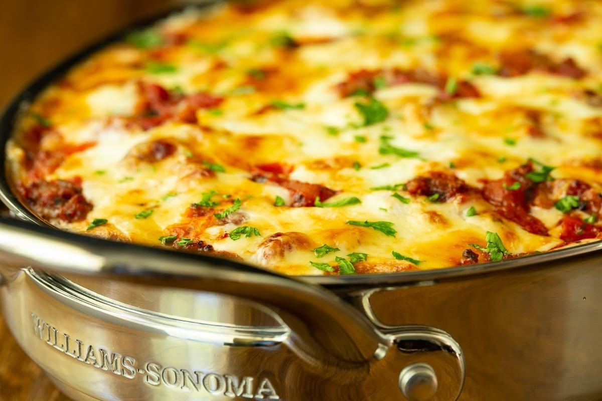 Horizontal extreme closeup photo of a pan of Eggplant Italian Sausage Gratin.