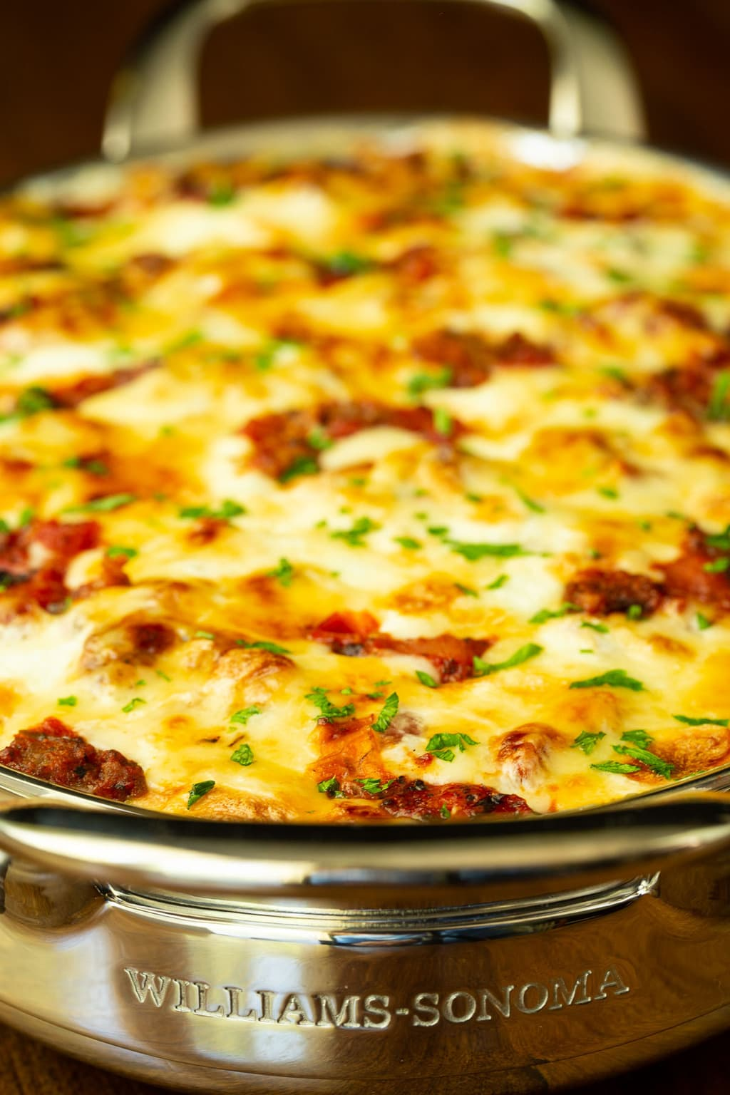 Vertical closeup photo of a stainless steel baking pan of Eggplant Italian Sausage Gratin.
