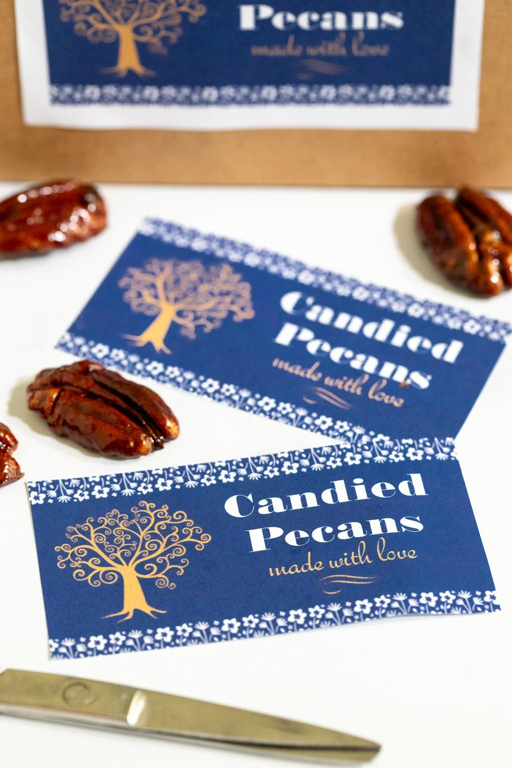Vertical photo of custom Easy Candied Pecan labels for gift giving.