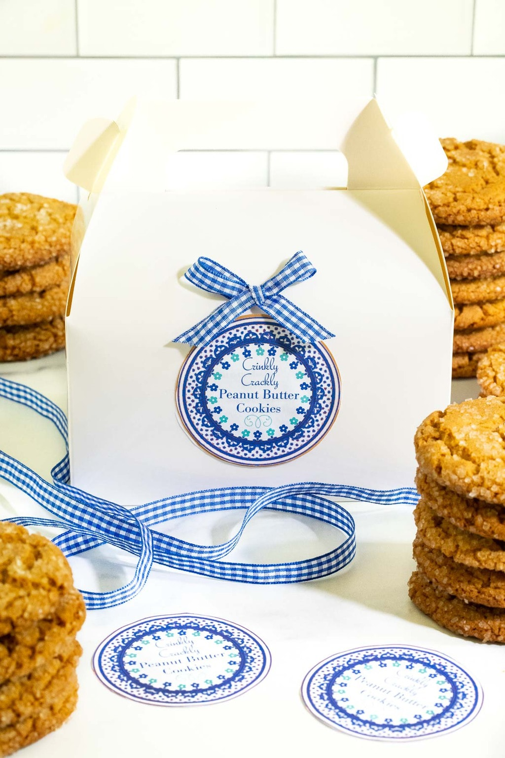 Vertical photo of a gift box and custom Crinkly Crackly Peanut Butter Cookie label.