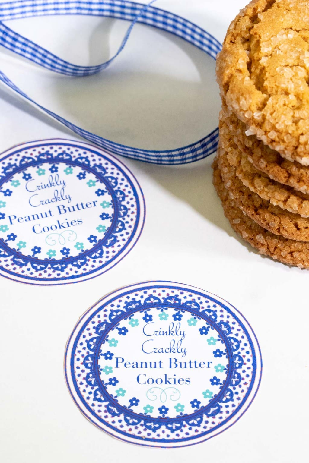 Vertical photo of a Crinkly Crackly Peanut Butter Cookie custom gift label next to a stack of cookies.