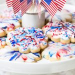 Horizontal closeup photo of a batch of Red, White, and Blue Glazed Shortbread Cookies