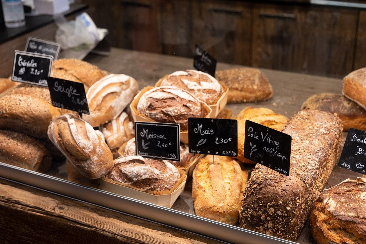 Horizontal closeup photo of a variety of breads available everyday at one of Argentiére's three bakeries (boulangeries).