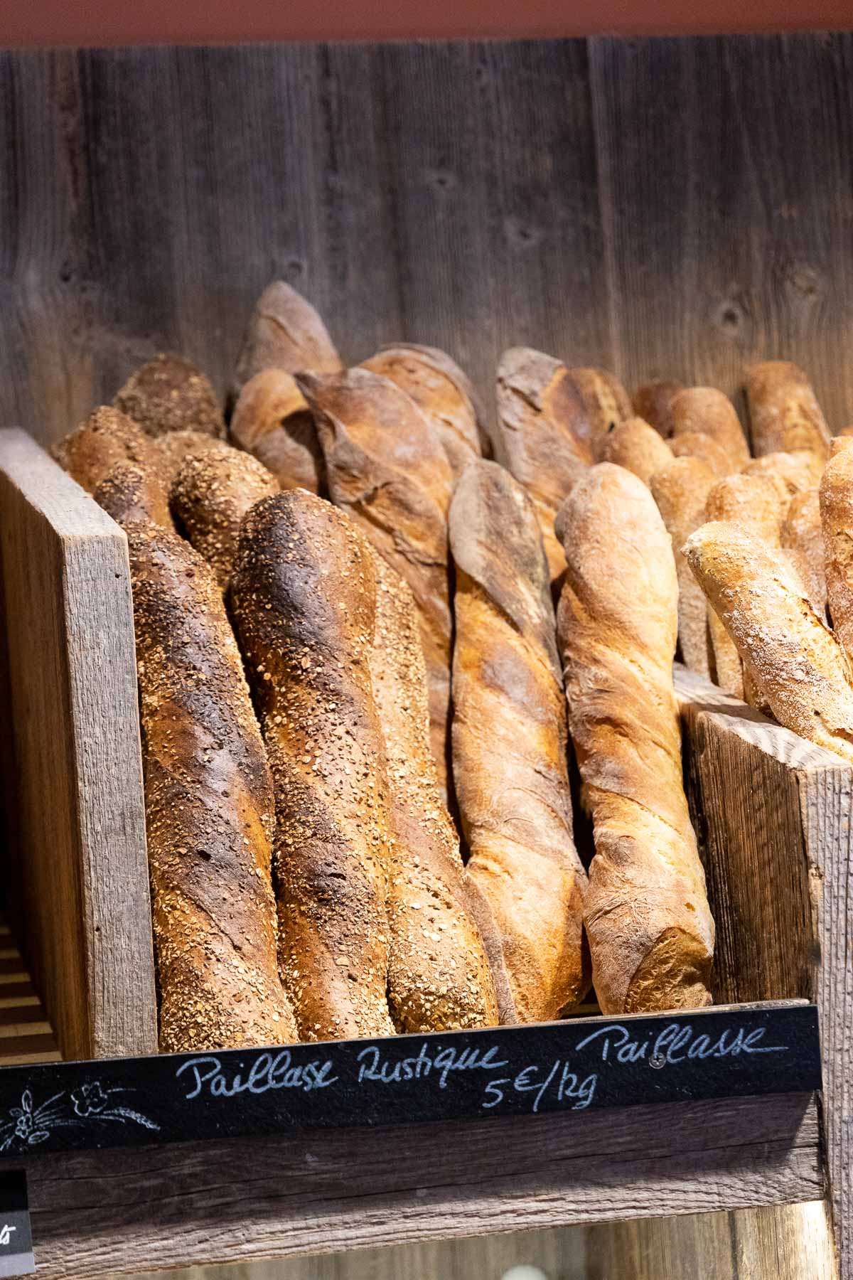 Vertical photo of stacks of various types of French bread available daily at Argentiére's three bakeries (boulangeries).